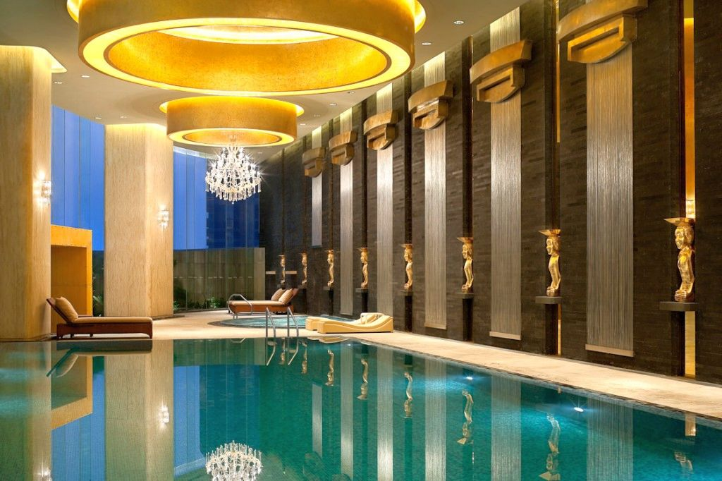 Indoor swimming pool designs with low lights and grecian for Swimming pool design 2015