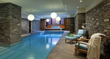 indoor swimming pool with stone wall