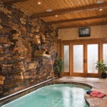 indoor tiny swimming pools with stone wall and wood ceiling