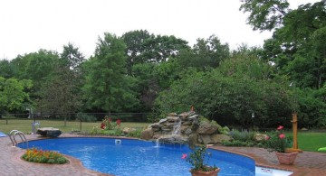 inground nature themed kidney shaped swimming pools