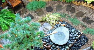 japanese garden designs for small spaces with stone and bamboo fountain