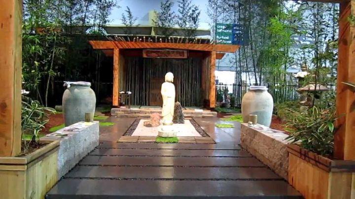 Japanese style backyard with pergola and wooden pathway for Japanese style gazebo plans