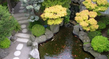 japanese style backyard with small pond and stone pathway