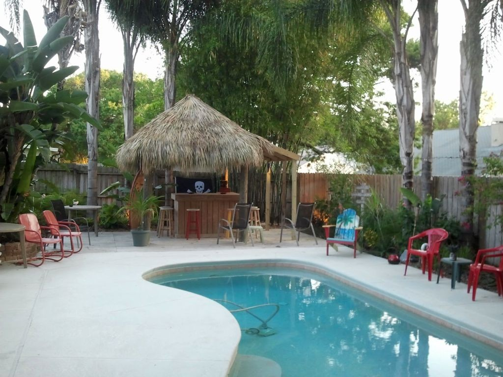 kidney shaped swimming pools with tiki hut