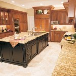 kitchen island with sink with marble countertop