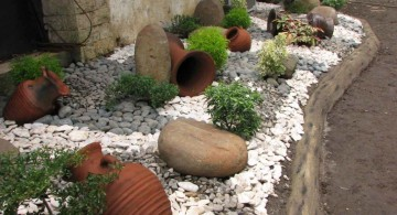 landscaping designs with big rocks and old jugs