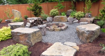landscaping designs with big rocks and outdoor fireplace