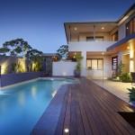 lap pool designs with dark wood deck