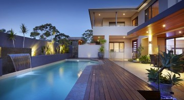 lap pool designs with dark wood deck