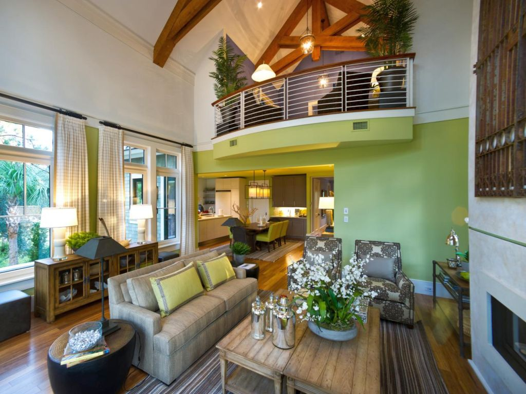 Lime green accent walls for living room with indoor balcony for Balcony living room design