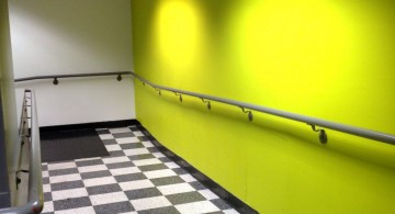 lime green accent walls for the hallway with black and white tile