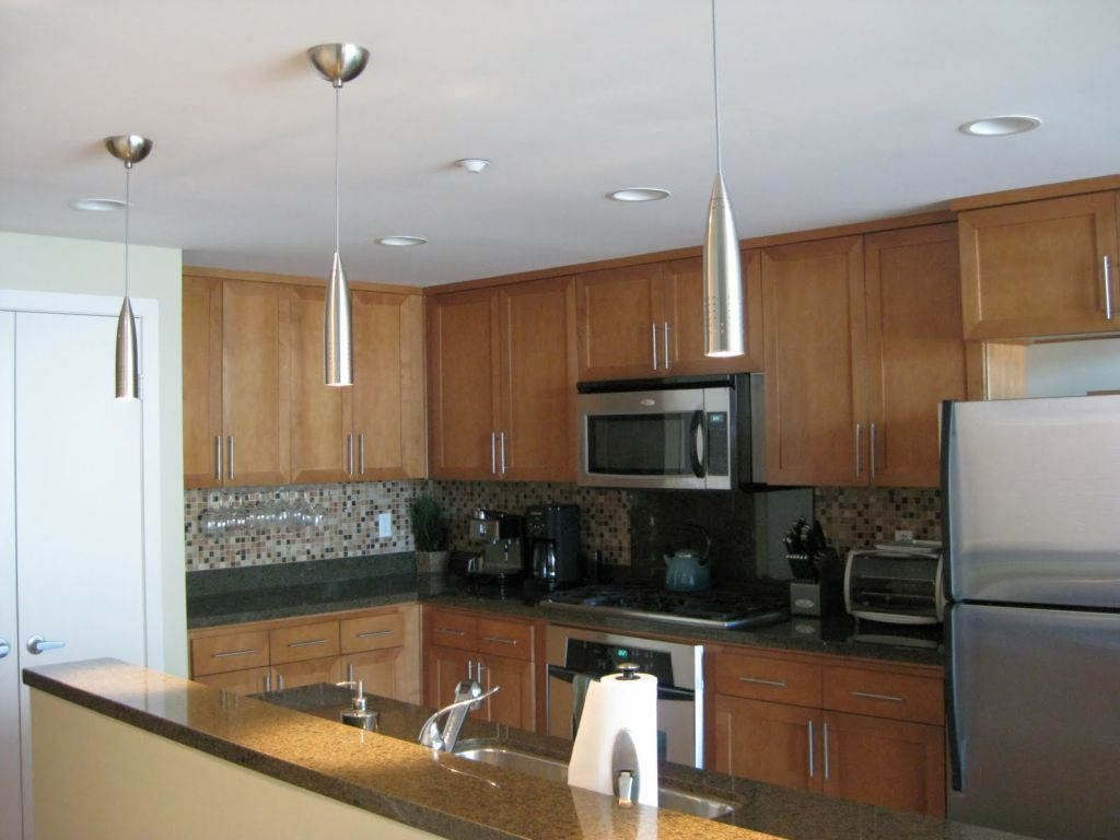 Long And Sleek Mini Pendant Lights Over Kitchen Island - Kitchen island pendant lighting canada