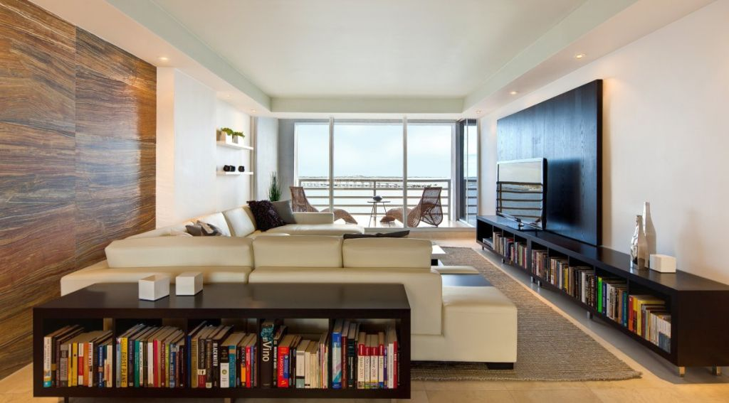long living room ideas with wide tv and low bookshelves - Long Living Room Design Ideas