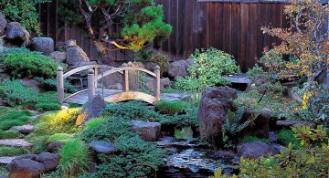lush japanese style backyard with small bridge