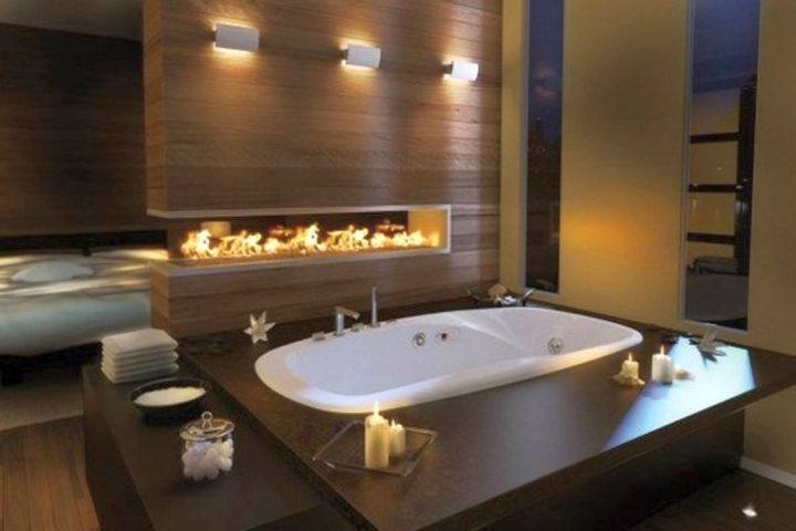 luxurious brown bathroom ideas with modern fireplace