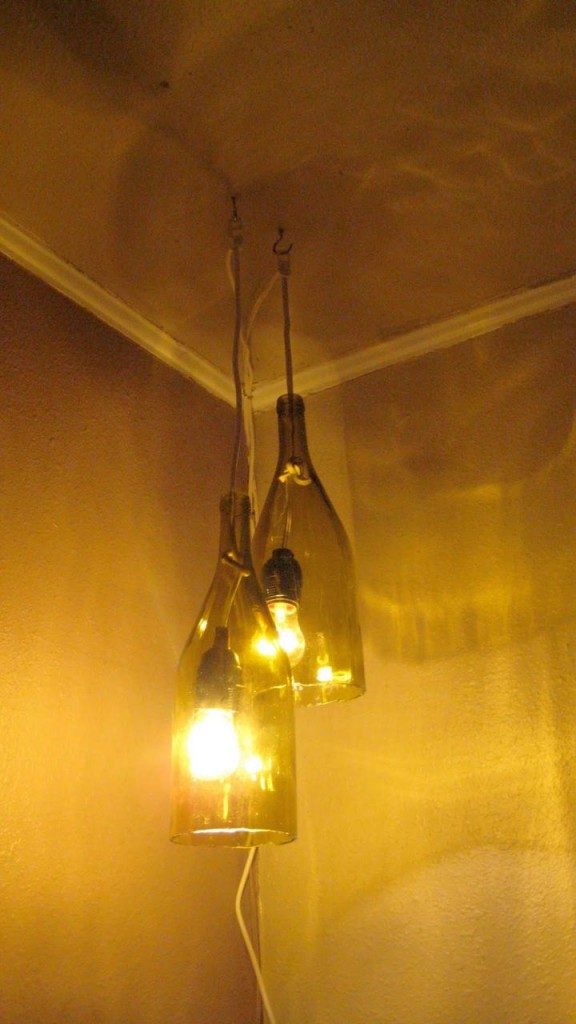 17 diy pendant lighting ideas you can get done with no fuss for How to make wine bottle lights