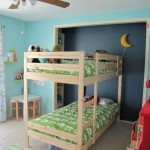 minimalist boys blue room with bunk beds