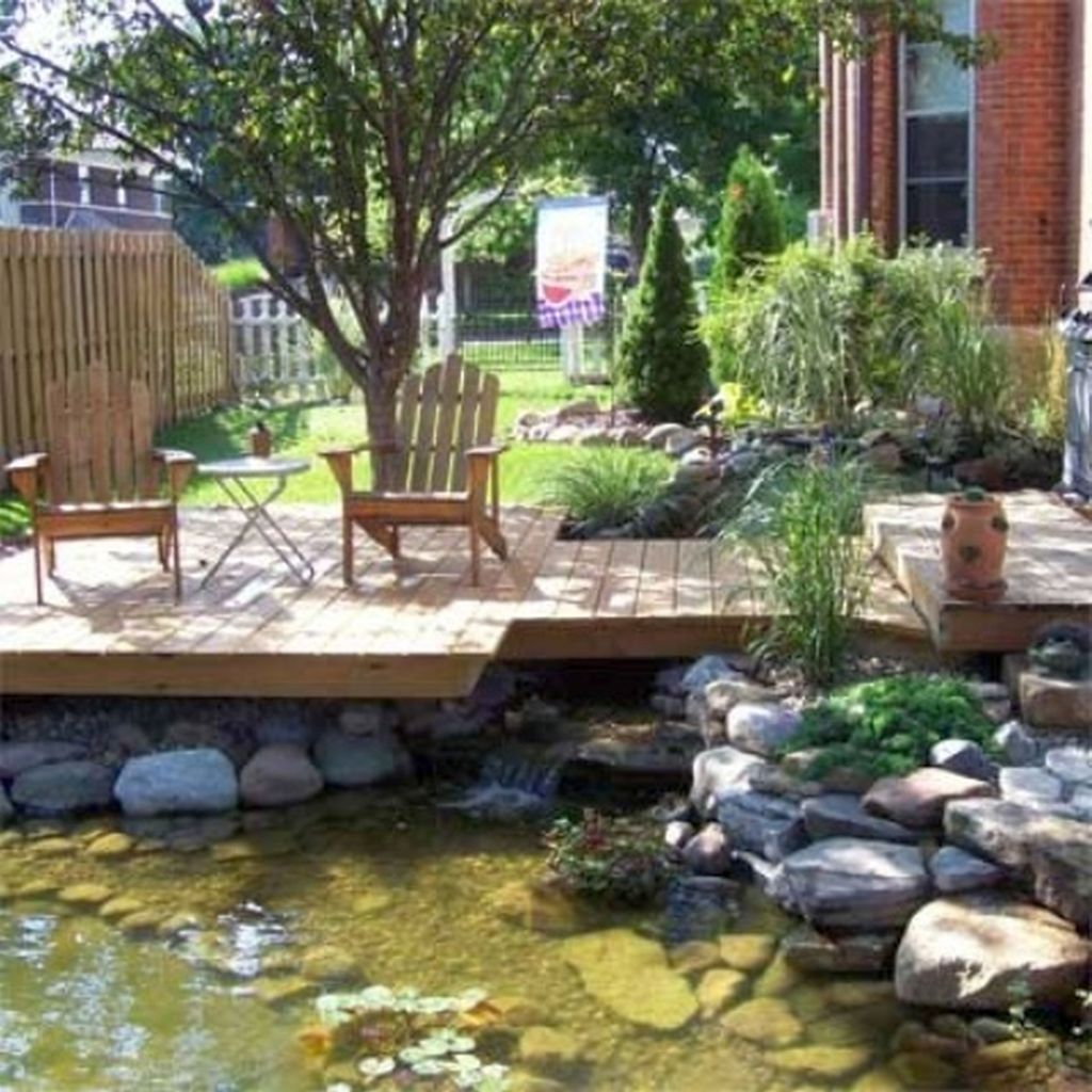 Modern deck design with koi pond for small space for Modern fish pond ideas