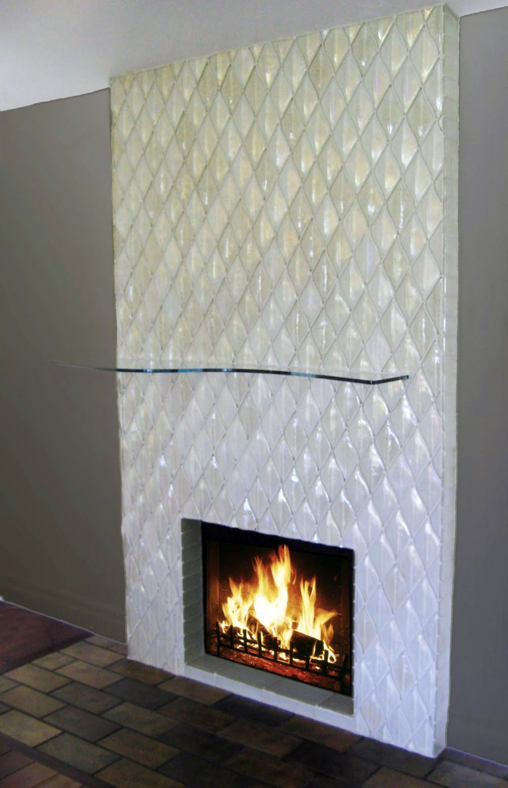 Modern fireplace designs with glass built in unique tiled wall - Build contemporary fireplace ideas ...