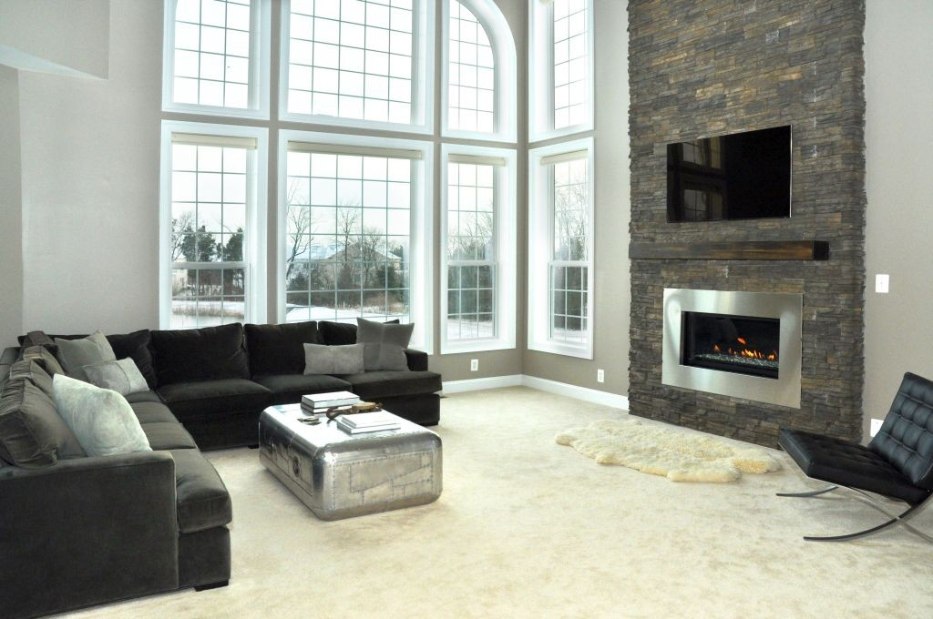 modern fireplace designs with glass in monochrome themed room