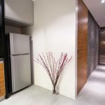 modern hallway decorating ideas with half wood and half brick wall