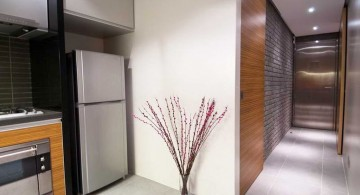modern hallway decorating ideas with half wood and half brick wall
