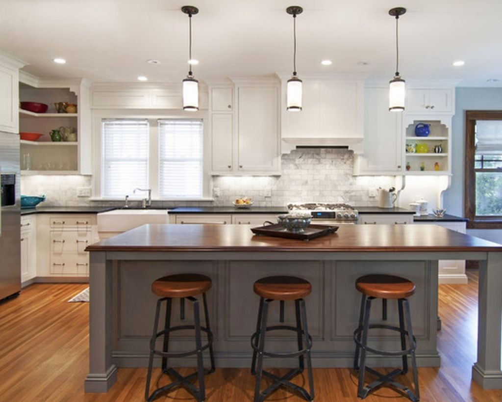 modern low mini pendant lights over kitchen island