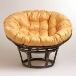 modern papasan chair with soft orange cushion