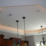modern tray ceiling bedroom with pendant lamps