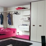 pink and black bedroom decor in plain white room
