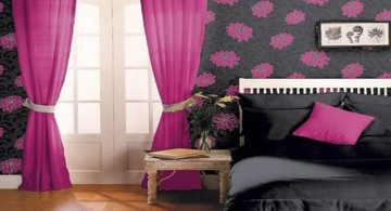 pink and black bedroom decor with black bed and pink curtains