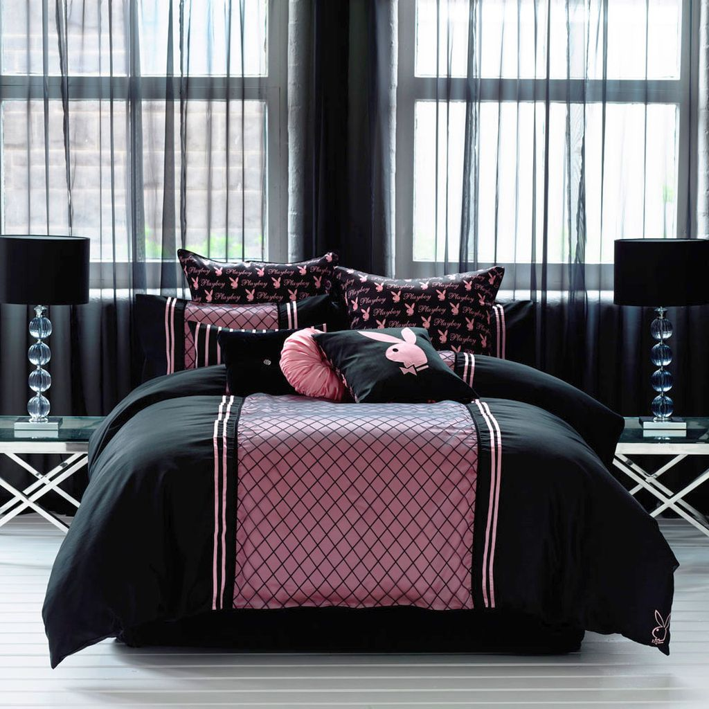 pink and black bedroom decor with playboy logos