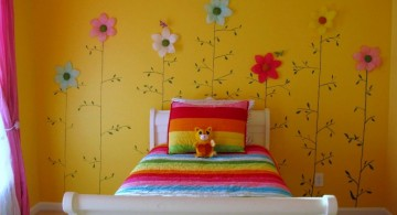 rainbow colored flowers on the wall cute girls bedroom ideas
