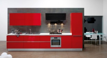 red lacquer kitchen cabinet on industrial grey wall for small kitchen