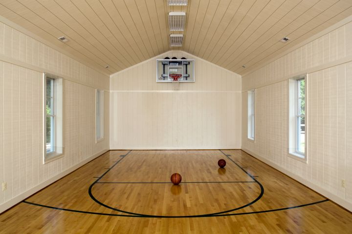 Repurpose old garage for indoor home basketball courts for Indoor basketball court design