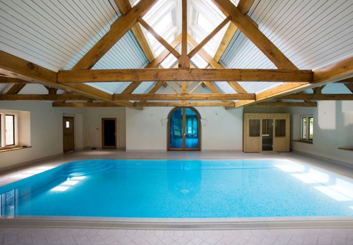rustic indoor swimming pool with skylight