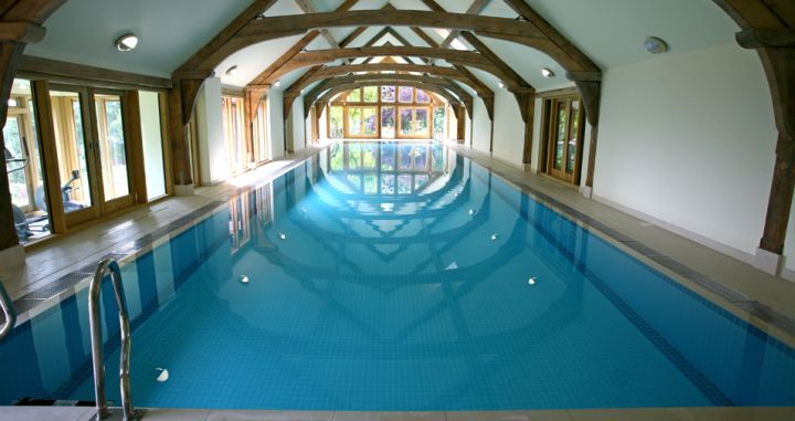 18 breathtaking indoor swimming pools for Domestic swimming pool design