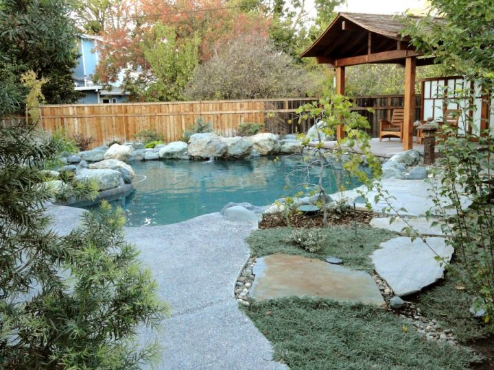 Rustic japanese style backyard with pergola and koi pond for Koi pool design
