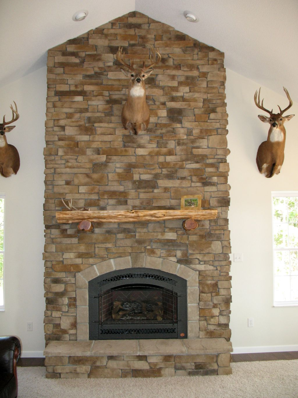Rustic stack stone fireplaces for lodge for Rustic rock fireplace designs