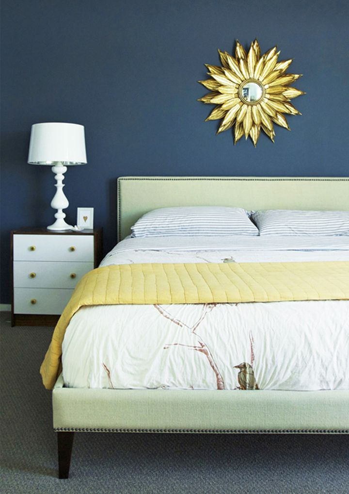 simple blue and gold bedroom with minimalist furniture