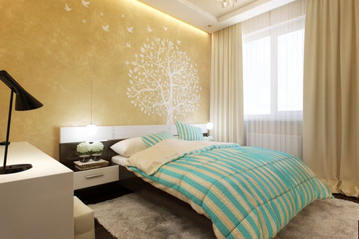 simple blue and gold bedroom with wall painting