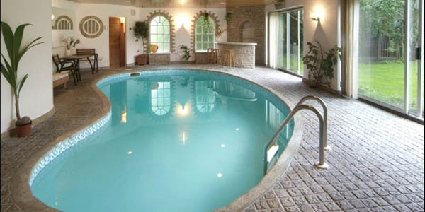 20 niftiest indoor swimming pool designs for Simple swimming pool designs