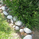 simple river stones for flower beds