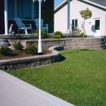 simple river stones for flower beds on front yard