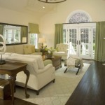 spacious beige living room walls with french double doors