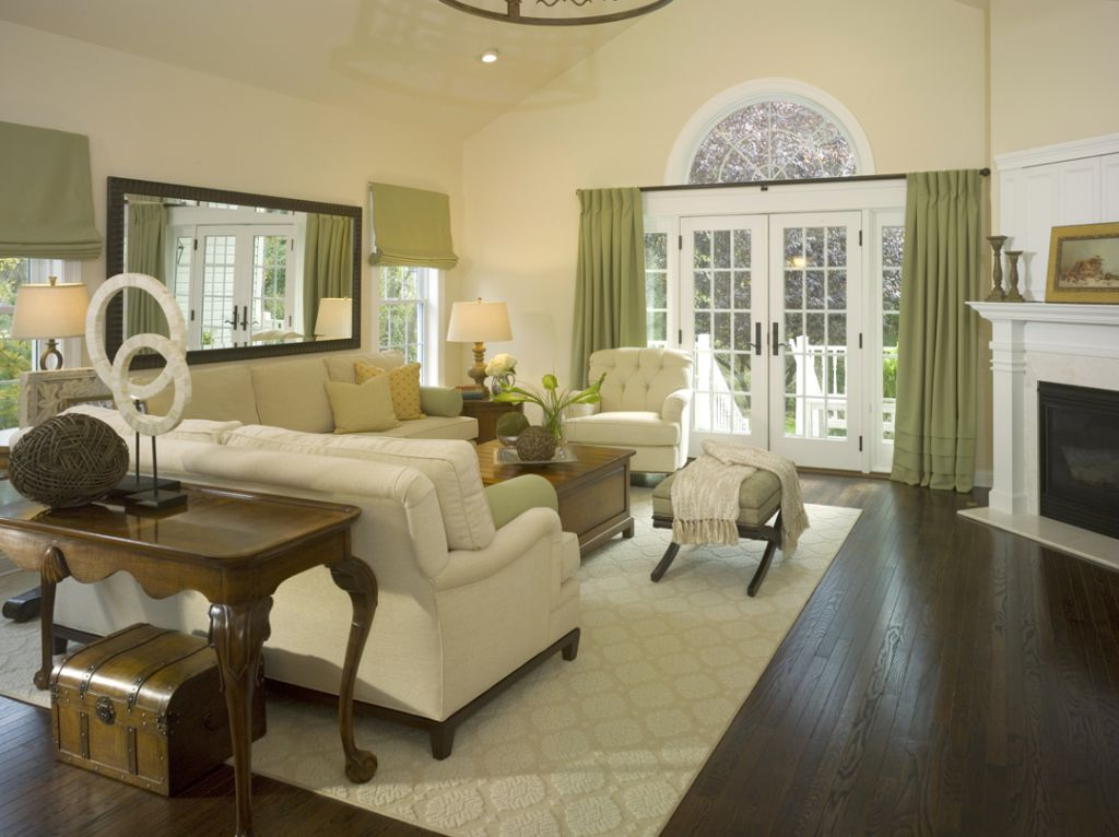 Spacious beige living room walls with french double doors for Living room designs with french doors