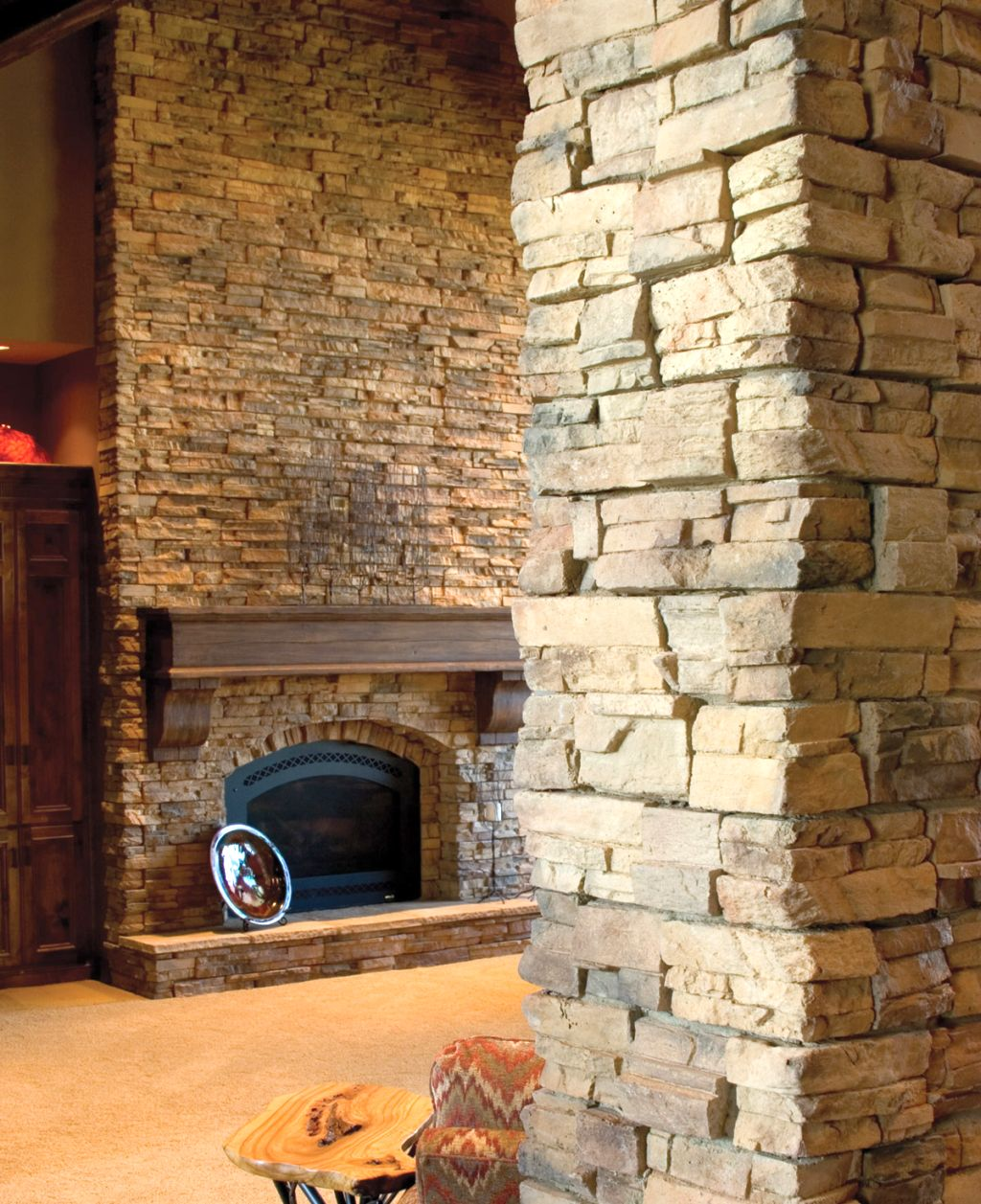 stack stone fireplaces behind the pillar. Black Bedroom Furniture Sets. Home Design Ideas