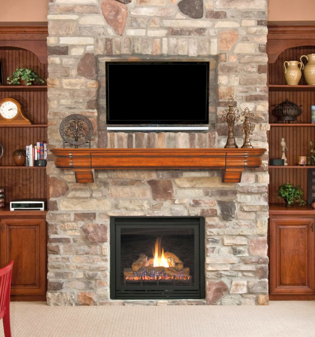 Stack stone fireplaces between the shelves for Bookshelves next to fireplace
