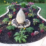 stones for flower beds with lotus fountain