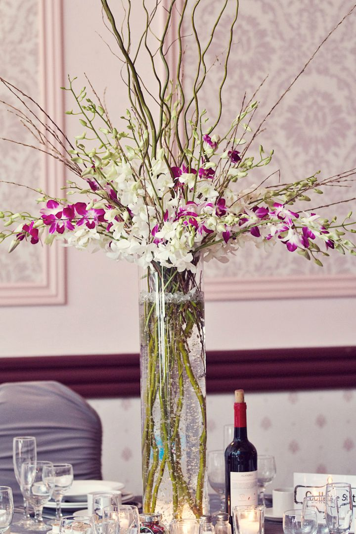 tall vase with branches and orchids
